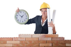 Woman construction worker with clock Royalty Free Stock Photo