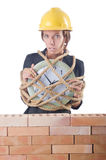 Woman construction worker with clock Stock Image