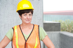 Woman construction worker in hard hat Royalty Free Stock Image