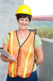 Woman construction worker in hard hat Stock Image