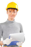 Woman construction worker holding clipboard with sheet isolated Stock Photos