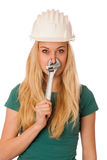 Woman with constructor helmet and tools gesturing stuffy nose Stock Images