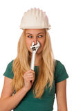 Woman with constructor helmet and tools gesturing stuffy nose Royalty Free Stock Image