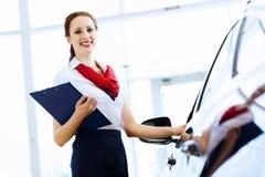 Woman consultant at car salon Royalty Free Stock Photo