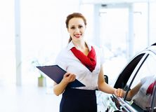 Woman consultant at car salon Stock Image