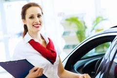 Woman consultant at car salon Stock Photos