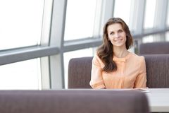 Woman consultant in the workplace in the Bank office. Photo with place for text stock photography