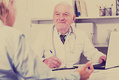 Woman on consultation with doctor Royalty Free Stock Photo
