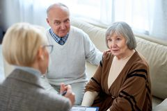 Woman consulting senior people stock photo