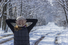 Woman contemplating the forest in winter day Stock Photos