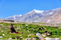 Woman contemplating a mountain range in Ladakh region, India stock images