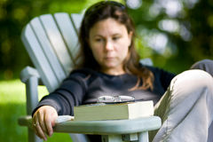 Woman contemplating after reading outside Stock Photography
