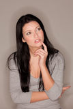 Woman in contemplative mood Stock Images