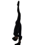 Woman contortionist exercising gymnastic yoga silhouette. One caucasian woman contortionist practicing gymnastic yoga in silhouette on white background stock images