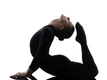 Woman contortionist  exercising gymnastic yoga   silhouette Royalty Free Stock Image