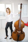 Woman with contrabass at sunny day Stock Photos