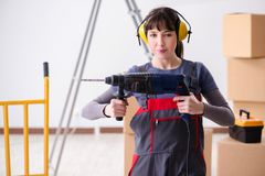 The woman contractor with hand drill at construction site stock photos
