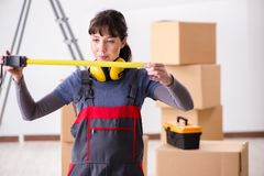 The woman contractor with measuring tape stock photography