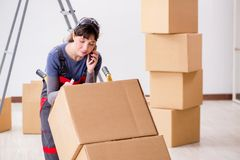 The woman contractor moving boxes in relocation concept. Woman contractor moving boxes in relocation concept Royalty Free Stock Photos