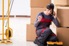 The woman contractor moving boxes in relocation concept. Woman contractor moving boxes in relocation concept Stock Images