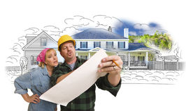 Woman with Contractor Over House Drawing and Photo on White stock photography