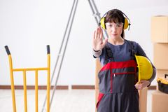 The woman contractor worker with noise cancelling headphones. Woman contractor worker with noise cancelling headphones royalty free stock images