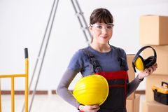 The woman contractor worker with noise cancelling headphones. Woman contractor worker with noise cancelling headphones stock photo