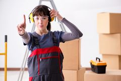 The woman contractor worker with noise cancelling headphones. Woman contractor worker with noise cancelling headphones royalty free stock photo