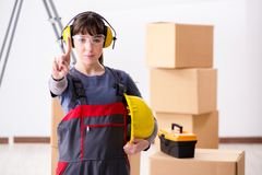 The woman contractor worker with noise cancelling headphones. Woman contractor worker with noise cancelling headphones stock image