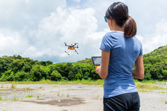 Woman control with drone Stock Photo