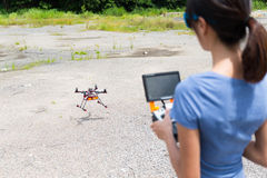 Woman controling the drone Royalty Free Stock Images
