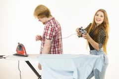 Woman controling man to do ironing Royalty Free Stock Images