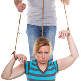 Woman is controlled by a headless man Stock Photos