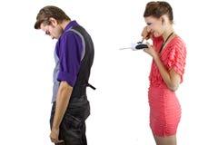 Woman Controlling Boyfriend Royalty Free Stock Photography