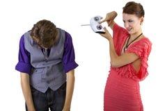 Woman Controlling Boyfriend Royalty Free Stock Photos