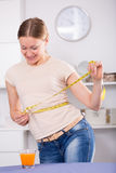Woman controlling waistline Stock Photos