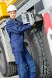 Woman at controls heavy plant vehicle Stock Photography