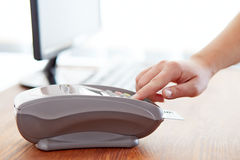Woman controls payment terminal Stock Photography