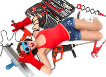 Woman contructor worker lying on a floor with construction set o Royalty Free Stock Image