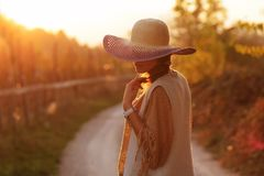 Woman on the contry side road. In sunset Stock Photo