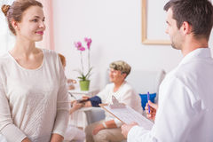 Woman during conversation with doctor Royalty Free Stock Photo