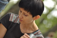 The woman conversing and thoughtful. Girl with earrings. Stock Images