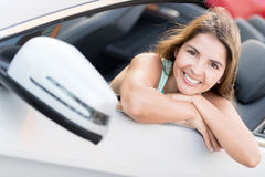 Woman in a convertible car Stock Images