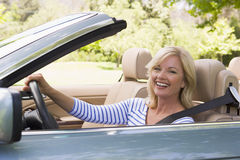 Woman in convertible car smiling stock photos