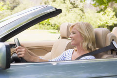 Woman in convertible car smiling Stock Photography
