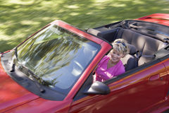 Woman in convertible car smiling Stock Photo
