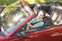 Woman in convertible car smiling Royalty Free Stock Image