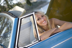 Woman in convertible car, smiling, portrait Stock Images