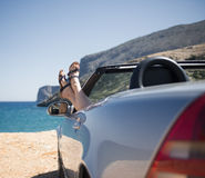 Woman in a convertible royalty free stock photo