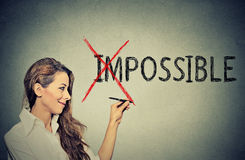 Woman converting the word impossible to possible Royalty Free Stock Photography